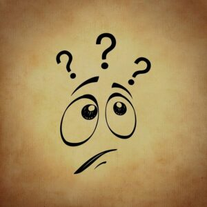 Cartoon face with three question marks above its head.